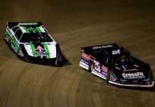 Brandon Overton (76) battles Jimmy Owens at East Bay Raceway Park. (Heath Lawson photo)