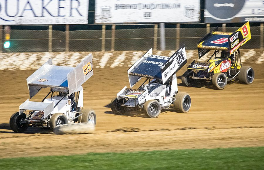 Todd McVay (89) moves by Robbie Price (21p) and Chase Randall during Sunday's ASCS Warrior Region event at Lake Ozark Speedway. (Brad Plant Photo)