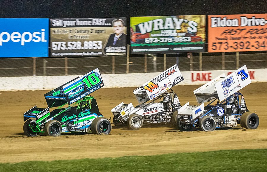 Jeremy Campbell (10c), Parker Price-Miller (14), and Ayrton Gennetten race for position during Sunday's ASCS Warrior Region event at Lake Ozark Speedway. (Brad Plant Photo)