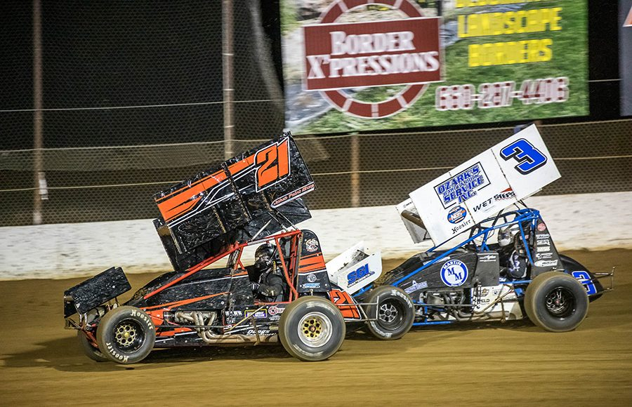 Miles Paulus (21) and Ayrton Genneten fight for position during Sunday's ASCS Warrior Region event at Lake Ozark Speedway. (Brad Plant Photo)