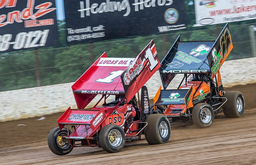 Sean McClelland (1) and Darrel Moser Jr. race for position during a heat race as part of Sunday's ASCS Warrior Region event at Lake Ozark Speedway. (Brad Plant Photo)