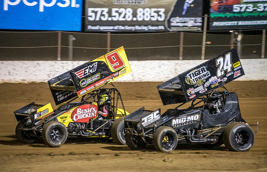 Chase Randell (9) and Garet Williamson race through turn two during Sunday's ASCS Warrior Region event at Lake Ozark Speedway. (Brad Plant Photo)