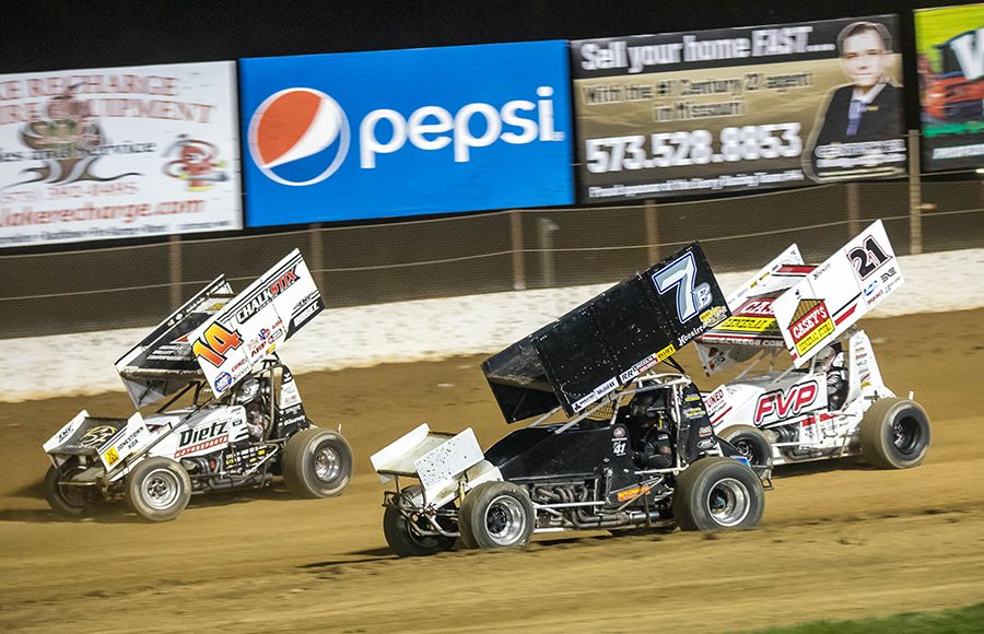 Parker Price-Miller (14), Ben Brown (7b) and Brian Brown battle for position during Sunday's ASCS Warrior Region event at Lake Ozark Speedway. (Brad Plant Photo)