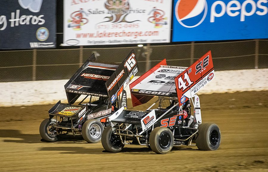 Dominic Scelzi (41) races under Sam Hafertepe Jr. during Sunday's ASCS Warrior Region event at Lake Ozark Speedway. (Brad Plant Photo)