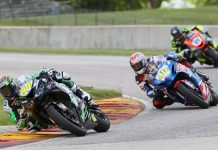 Richie Escalante (54) won his first career Supersport race after Sean Dylan Kelly (40) crashed out of their battle. Brandon Paasch (21) finished second. (Brian J. Nelson Photo)