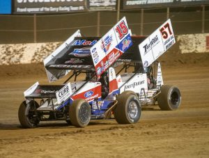 Donny Schatz (15) races under Kyle Larson at Lake Ozark Speedway. (Brad Plant photo)