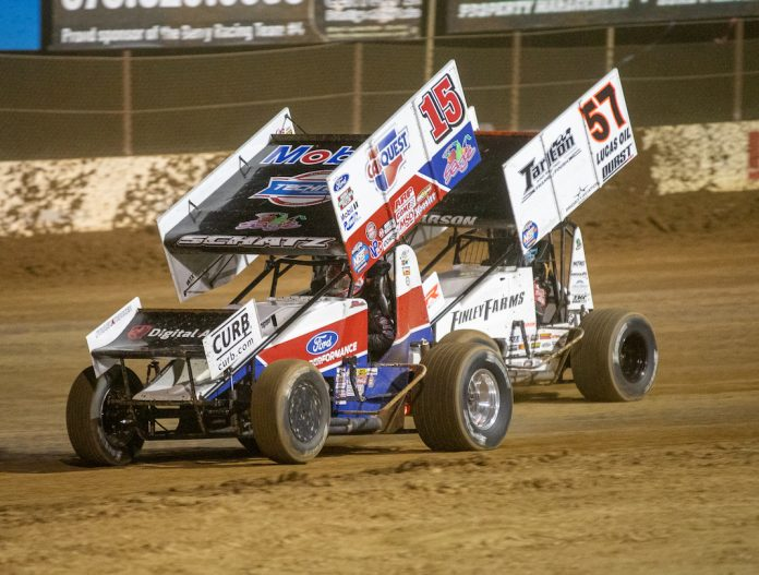 Donny Schatz (15) races under Kyle Larson at Lake Ozark Speedway. (Brad Plant photo)