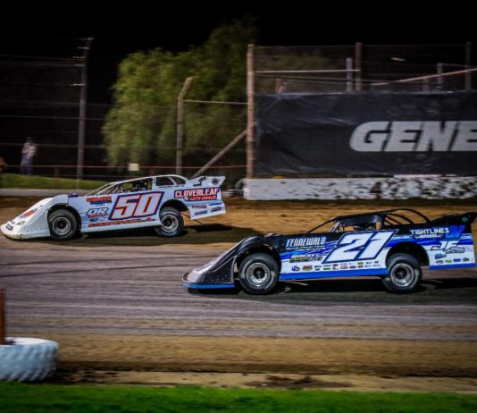 Three-time defending track champ Johnny Fennewald (21) closes in on Kaeden Cornell in the final laps Saturday night at Lucas Oil Speedway. (GS Stanek Racing Photography)