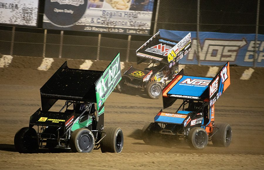 Shane Stewart (71) races ahead of Sheldon Haudenschild (17) and David Gravel during Saturday's World of Outlaws NOS Energy Drink Sprint Car Series event at Lake Ozark Speedway. (Brad Plant Photo)