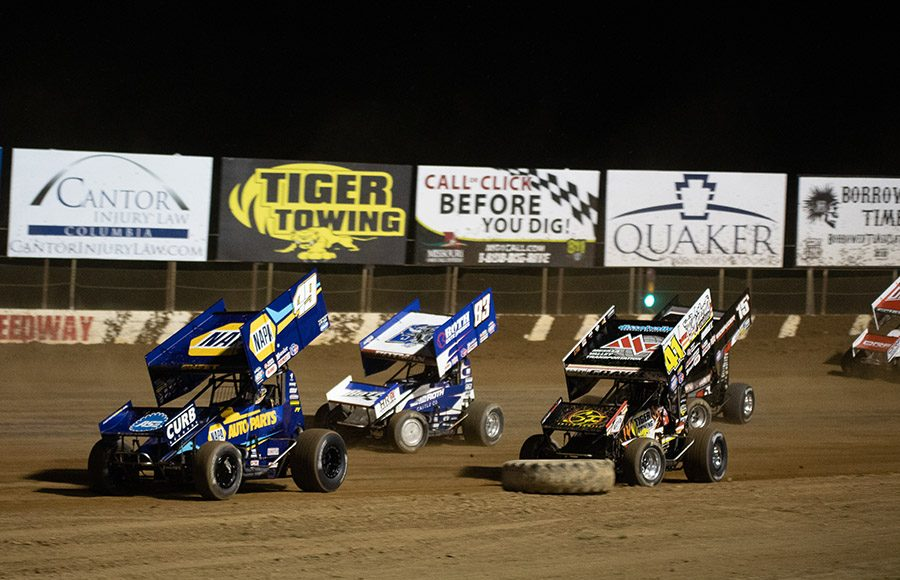 Brad Sweet (49) leads a pack of cars during Saturday's World of Outlaws NOS Energy Drink Sprint Car Series event at Lake Ozark Speedway. (Brad Plant Photo)