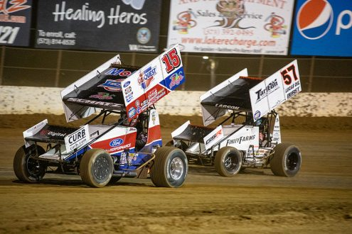 Donny Schatz (15) leads Kyle Larson during Saturday's World of Outlaws NOS Energy Drink Sprint Car Series event at Lake Ozark Speedway. (Brad Plant Photo)