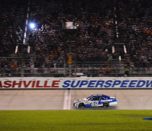 Carl Edwards takes the checkered flag at Nashville Superspeedway in 2011. (NASCAR photo)