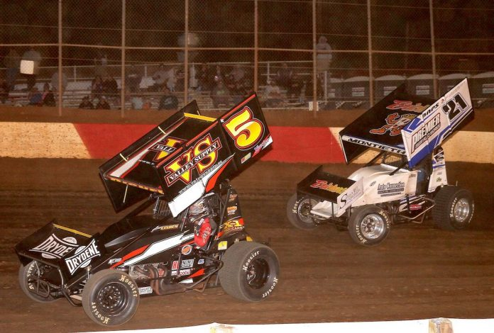 Dylan Cisney (5), shown battling Brian Montieth earlier this year, won Saturday's sprint car feature at Lincoln Speedway. (Dan Demarco photo)
