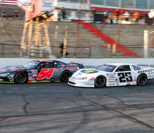 Matt Craig (54) battles Bubba Pollard as they cross under the white flag during Saturday's CARS Super Late Model Tour feature at Hickory Motor Speedway. (Adam Fenwick Photo)