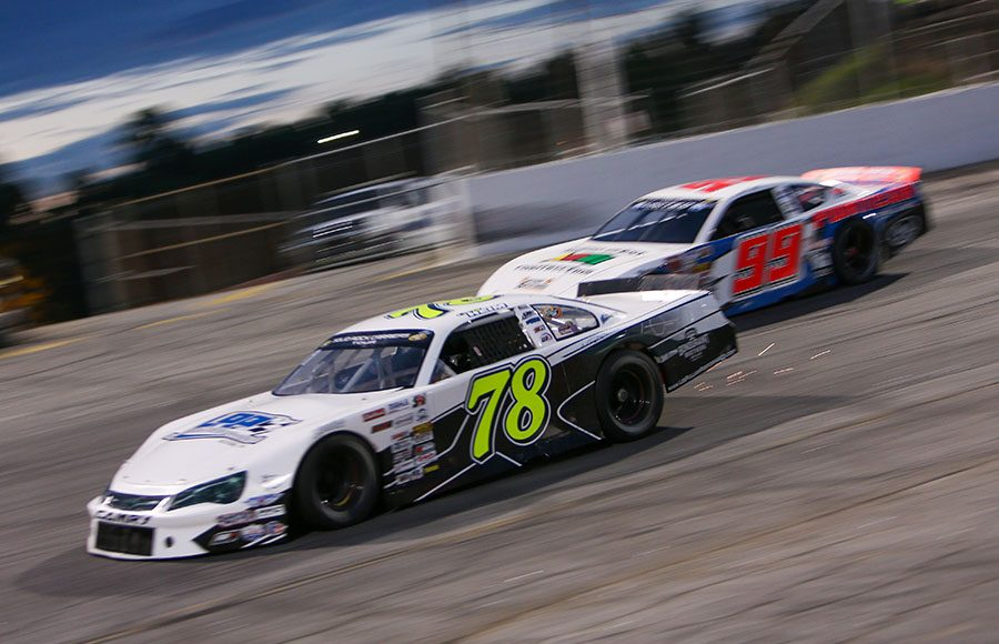 Corey Heim (77) battles Layne Riggs during the late model stock portion of Saturday's CARS Tour event at Hickory Motor Speedway. (Adam Fenwick Photo)