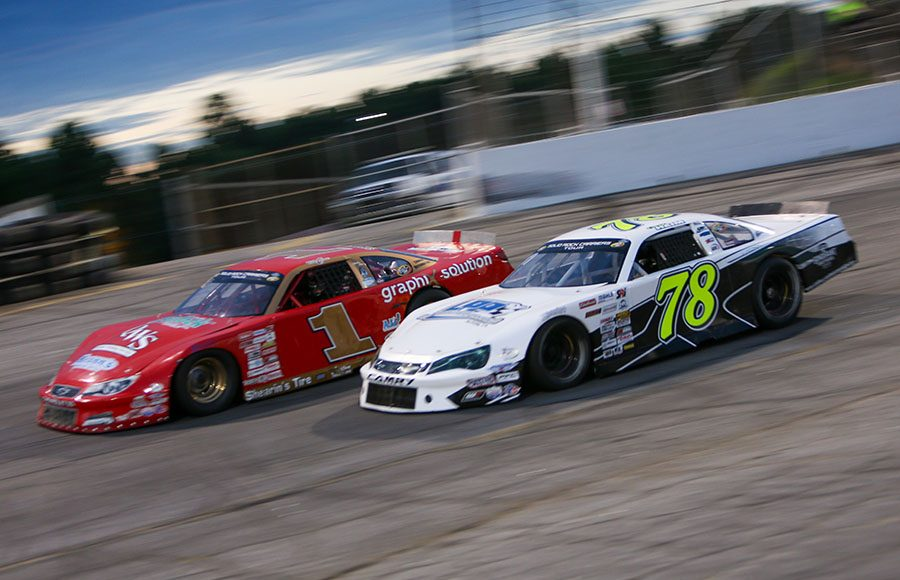 Corey Heim (78) races alongside Craig Moore during the late model stock portion of Saturday's CARS Tour event at Hickory Motor Speedway. (Adam Fenwick Photo)