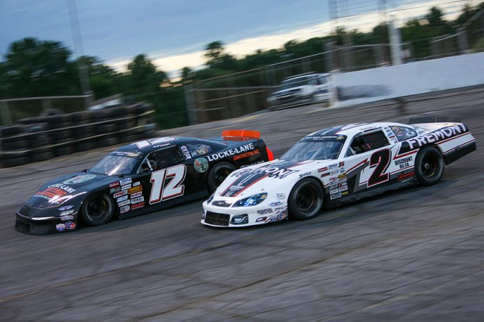 Brandon Pierce (2) races under Gage Painter during the late model stock portion of Saturday's CARS Tour event at Hickory Motor Speedway. (Adam Fenwick Photo)