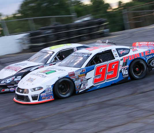 Layne Riggs (99) battles Mini Tyrrell during the late model stock portion of Saturday's CARS Tour event at Hickory Motor Speedway. (Adam Fenwick Photo)