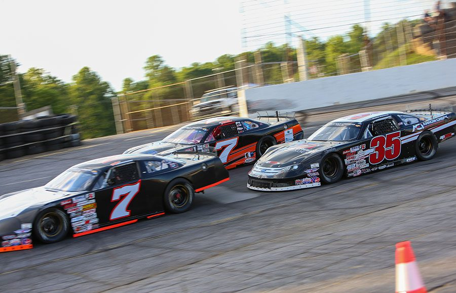 Tyler Church (7) and Jake Garcia (35) race to the inside of Justin Crider during the super late model portion of Saturday's CARS Tour event at Hickory Motor Speedway. (Adam Fenwick Photo)