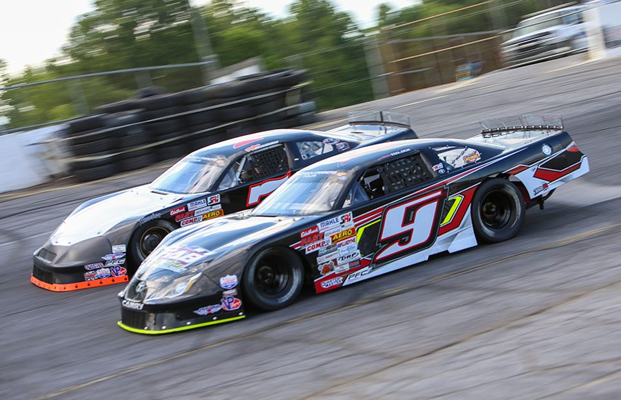 Hudson Halder (9) battles Tyler Church during the super late model portion of Saturday's CARS Tour event at Hickory Motor Speedway. (Adam Fenwick Photo)