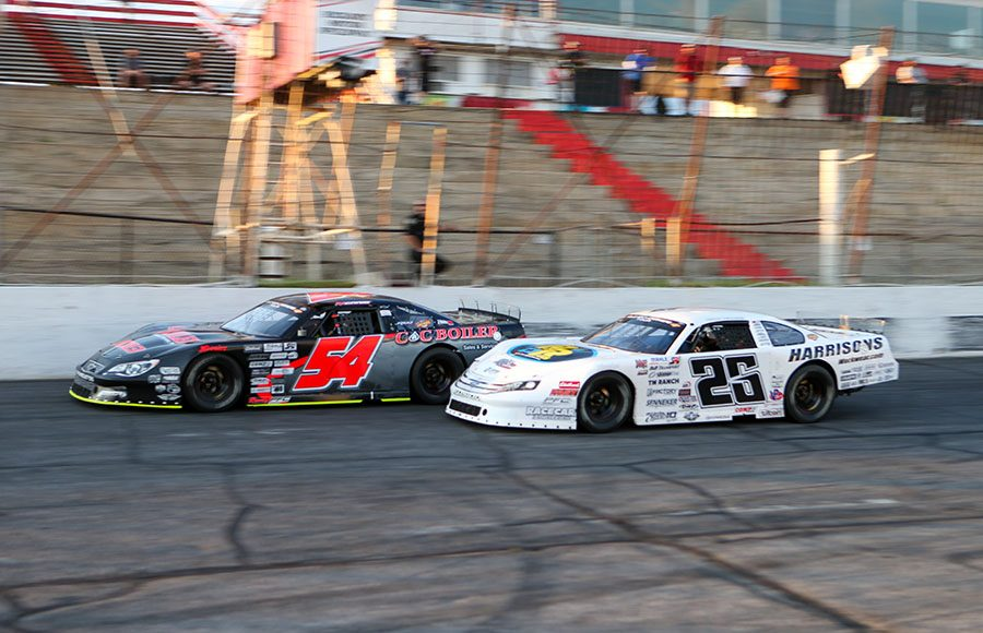 Matt Craig (54) battles Bubba Pollard for the race lead as they race under the white flag during the super late model portion of Saturday's CARS Tour event at Hickory Motor Speedway. (Adam Fenwick Photo)