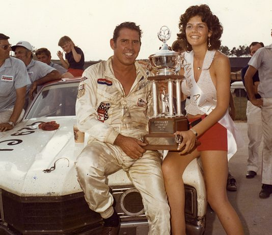 HAMPTON, GA ? July 22, 1973: David Pearson is joined my Miss Atlanta International Raceway in victory lane after Pearson came home victorious in the Dixie 500 NASCAR Cup race, giving him a sweep of the two Cup races held at Atlanta during the year. Pearson was virtually unbeatable during the Cup season, winning 11 of the 18 races he and his Wood Brothers team entered. (Photo by ISC Images & Archives via Getty Images)