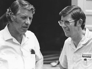 Glen and Leonard Wood talk outside the garage area at a NASCAR Cup race in the 1970s. (ISC Images Archives via Getty Images)
