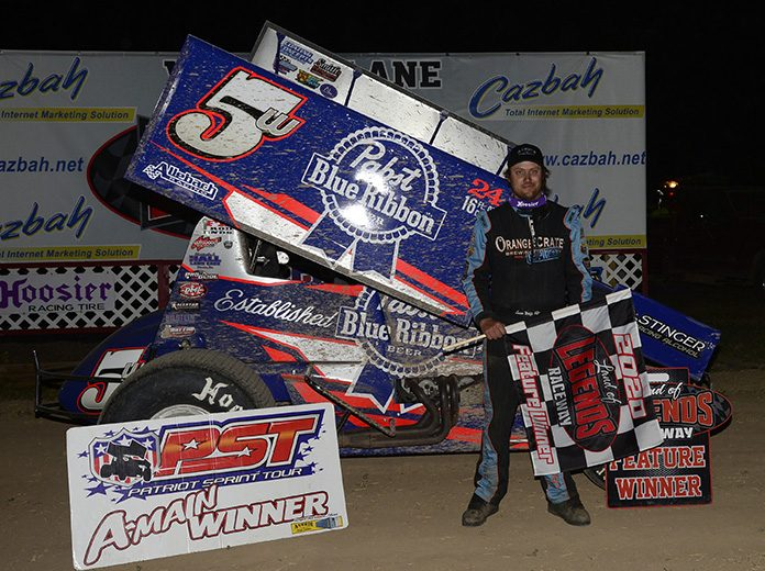 Lucas Wolfe in victory lane Wednesday at Land of Legends Raceway. (Don Romeo Photo)