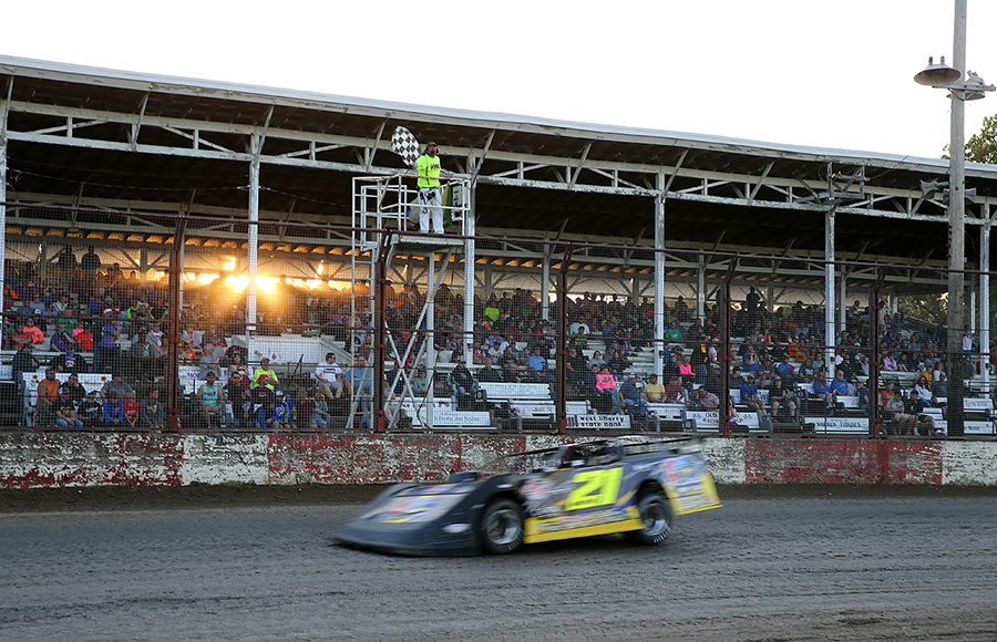 Billy Moyer passes under the checkered flag to win Sunday's Lucas Oil MLRA feature at West Liberty Raceway. (Mike Ruefer Photo)