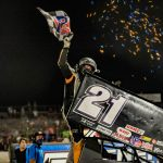 Carson Short celebrates victory at Triple-State Speedway. (Brad Plant photo)