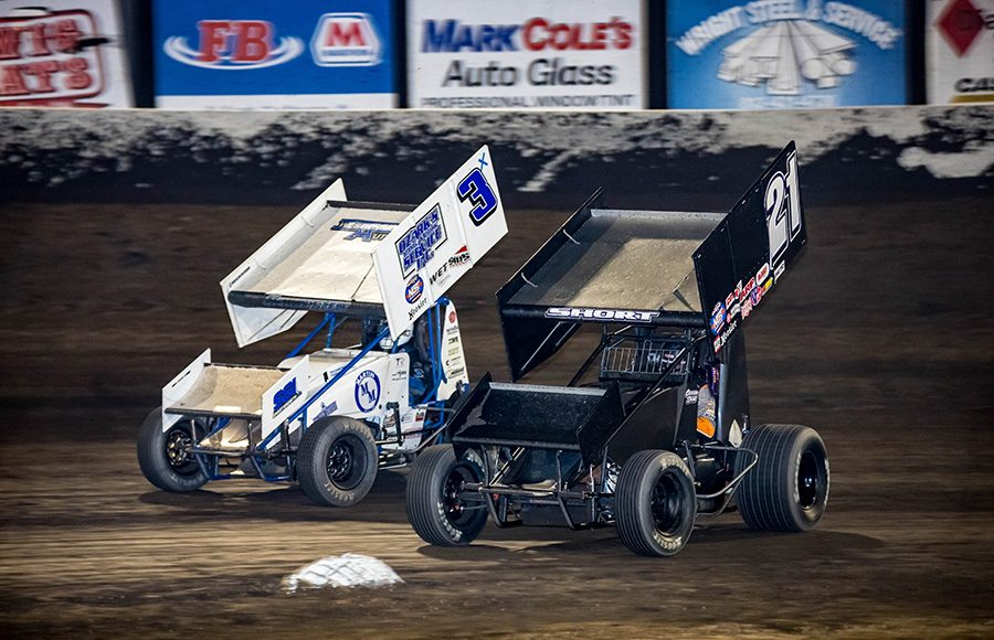 Carson Short (21) battles Ayrton Gennetten during Friday's World of Outlaws NOS Energy Drink Sprint Car Series event at Tri-State Speedway. (Brad Plant Photo)