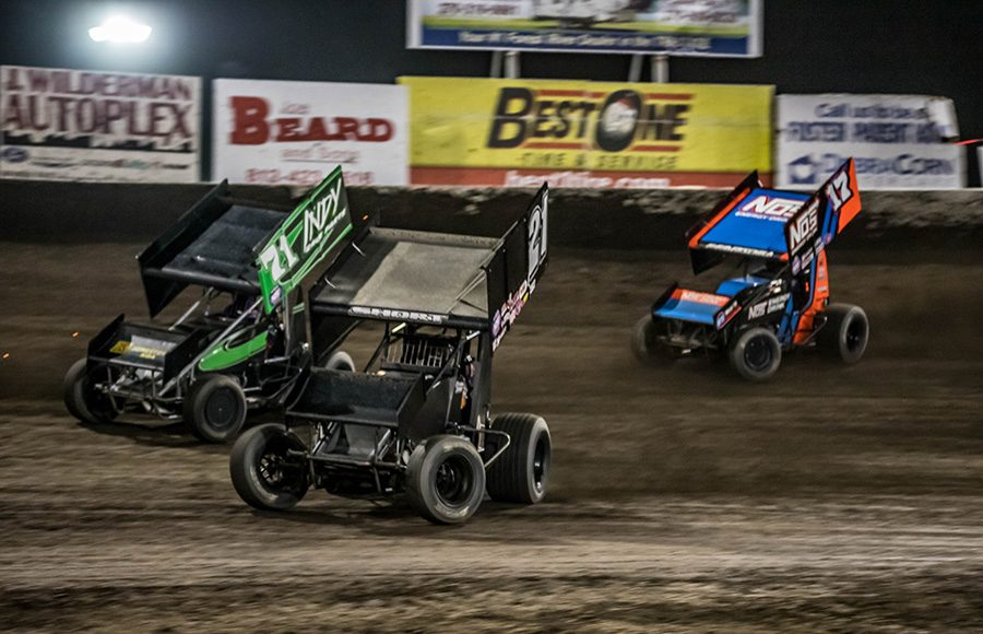 Carson Short (21) races under Shane Stewart (71) while Sheldon Haudenschild gives chase during Friday's World of Outlaws NOS Energy Drink Sprint Car Series event at Tri-State Speedway. (Brad Plant Photo)