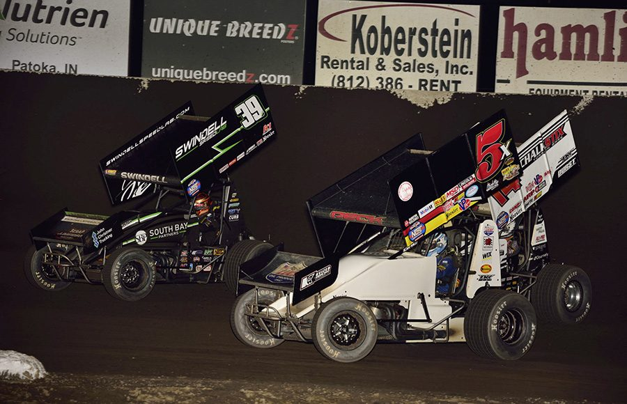 Sammy Swindell (39), Justin Peck (5x) and Parker Price-Miller battle for position during Friday's World of Outlaws NOS Energy Drink Sprint Car Series event at Tri-State Speedway. (Mark Funderburk Photo)