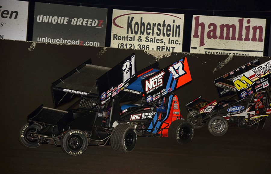 Carson Short (21) races ahead of Sheldon Haudenschild (17) and David Gravel during Friday's World of Outlaws NOS Energy Drink Sprint Car Series event at Tri-State Speedway. (Mark Funderburk Photo)