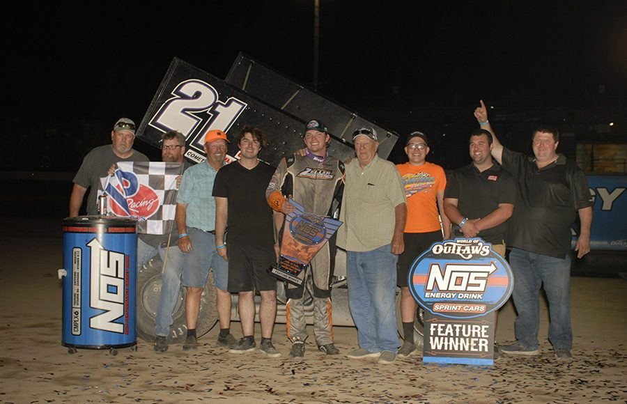 Carson Short poses in victory lane with his crew after winning Friday's World of Outlaws NOS Energy Drink Sprint Car Series feature at Tri-State Speedway. (Mark Funderburk Photo)