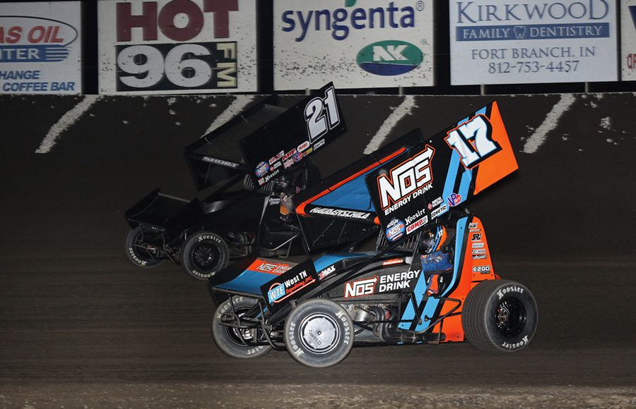 Sheldon Haudenschild (17) battles Carson Short during Friday's World of Outlaws NOS Energy Drink Sprint Car Series event at Tri-State Speedway. (Neil Cavanah Photo)