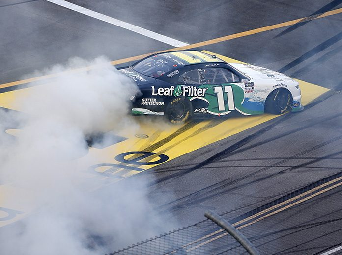 Justin Haley celebrates with a burnout after winning Saturday's NASCAR Xfinity Series Unhinged 300 at Talladega Superspeedway. (Brian Lawdermilk/Getty Images Photo)