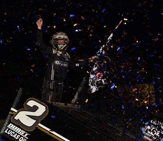Carson Macedo celebrates after winning Saturday's World of Outlaws NOS Energy Drink Sprint Car Series feature at Tri-State Speedway. (Mark Funderburk Photo)