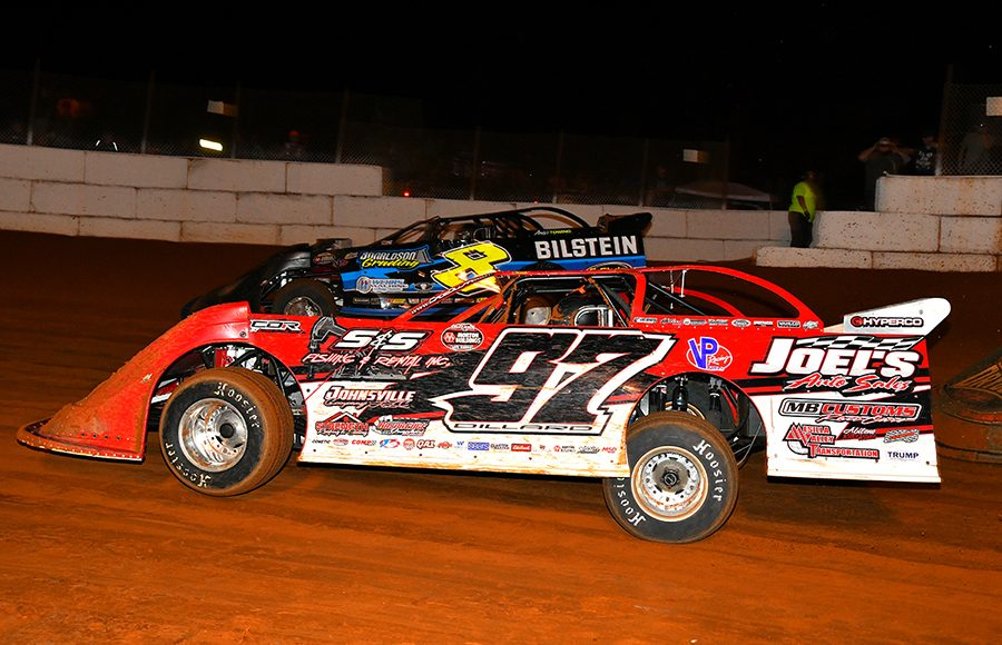 Cade Dillard (97) races under Kyle Strickler during Friday's World of Outlaws Morton Buildings Late Model Series event at Volunteer Speedway. (Michael Moats Photo)