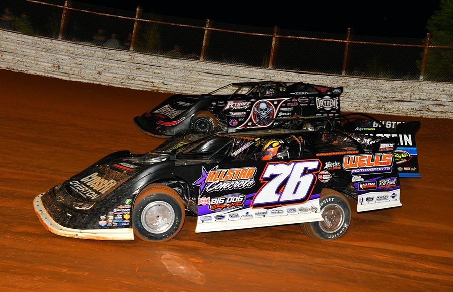 Brandon Overton (76) battles Scott Bloomquist during Friday's World of Outlaws Morton Buildings Late Model Series event at Volunteer Speedway. (Michael Moats Photo)