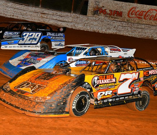 Donald McIntosh (7), Vic Hill (center), and Travis Fultz battle for a transfer spot during a heat race on Saturday during World of Outlaws Morton Buildings Late Model Series competition at Volunteer Speedway. (Michael Moats Photo)