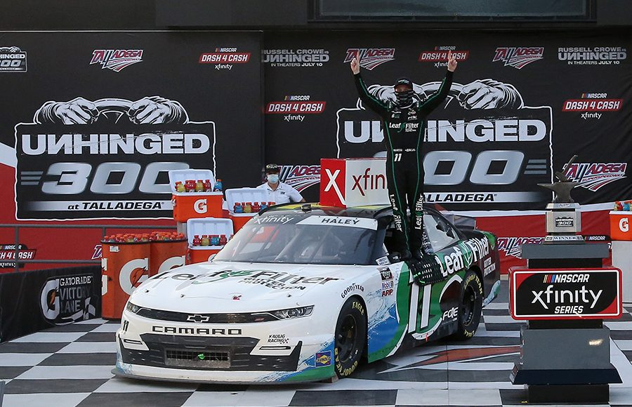Justin Haley poses in victory lane after winning Saturday's NASCAR Xfinity Series Unhinged 300 at Talladega Superspeedway. (Chris Graythen/Getty Images Photo)