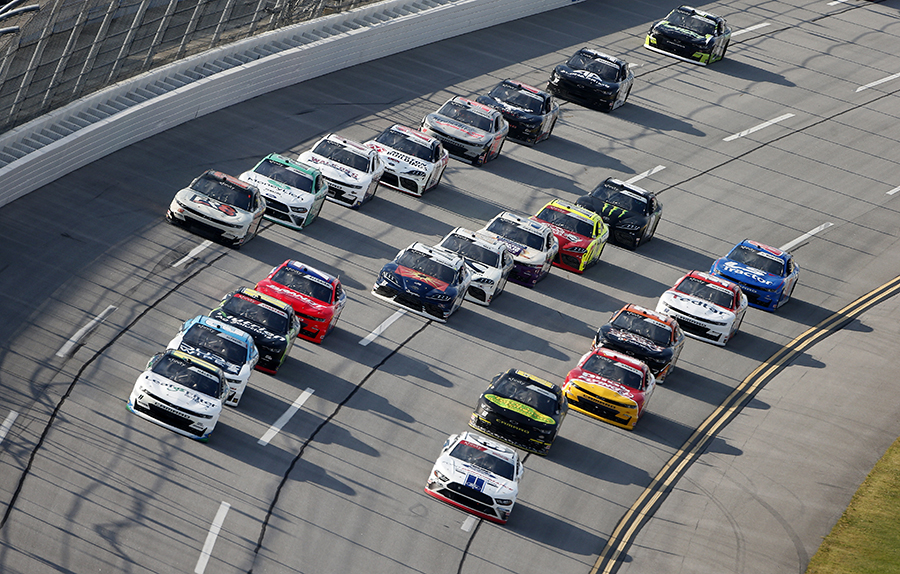 Justin Haley (11) leads the pack during Saturday's NASCAR Xfinity Series Unhinged 300 at Talladega Superspeedway. (Brian Lawdermilk/Getty Images Photo)