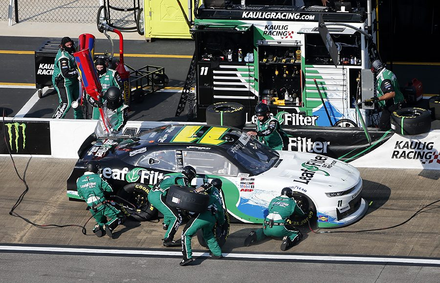 Justin Haley's crew goes to work during a pit stop as part of Saturday's NASCAR Xfinity Series Unhinged 300 at Talladega Superspeedway. (Brian Lawdermilk/Getty Images Photo)