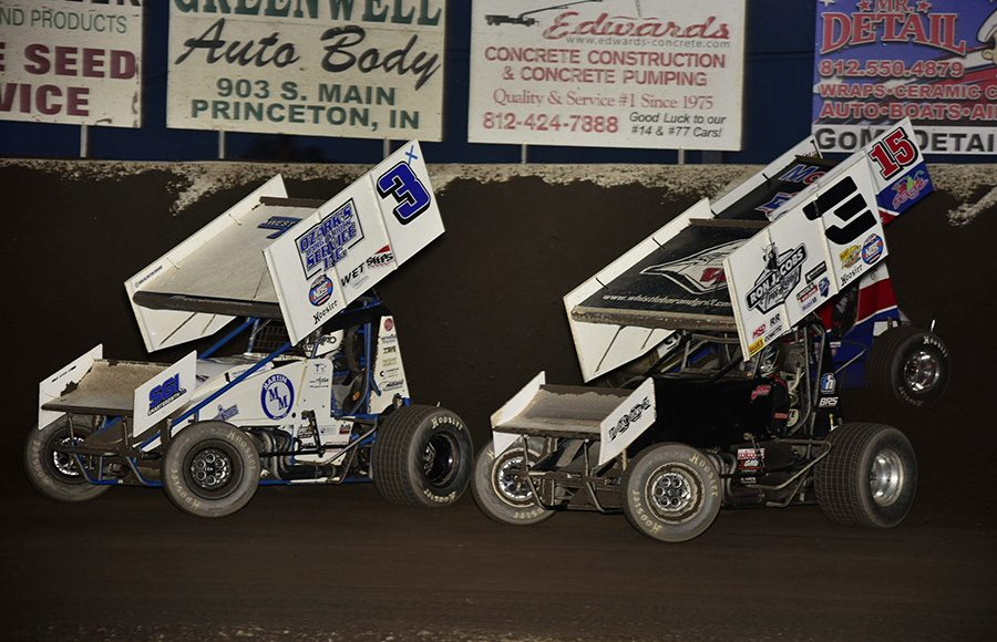 Ayrton Gennetten (3x), Jac Haudenschild (3) and Donny Schatz race for position during Saturday's World of Outlaws NOS Energy Drink Sprint Car Series event at Tri-State Speedway. (Mark Funderburk Photo)
