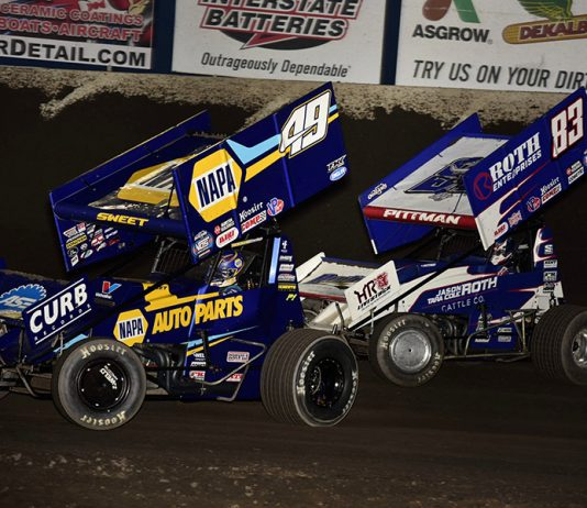 Brad Sweet (49) races ahead of Daryn Pittman during Saturday's World of Outlaws NOS Energy Drink Sprint Car Series event at Tri-State Speedway. (Mark Funderburk Photo)