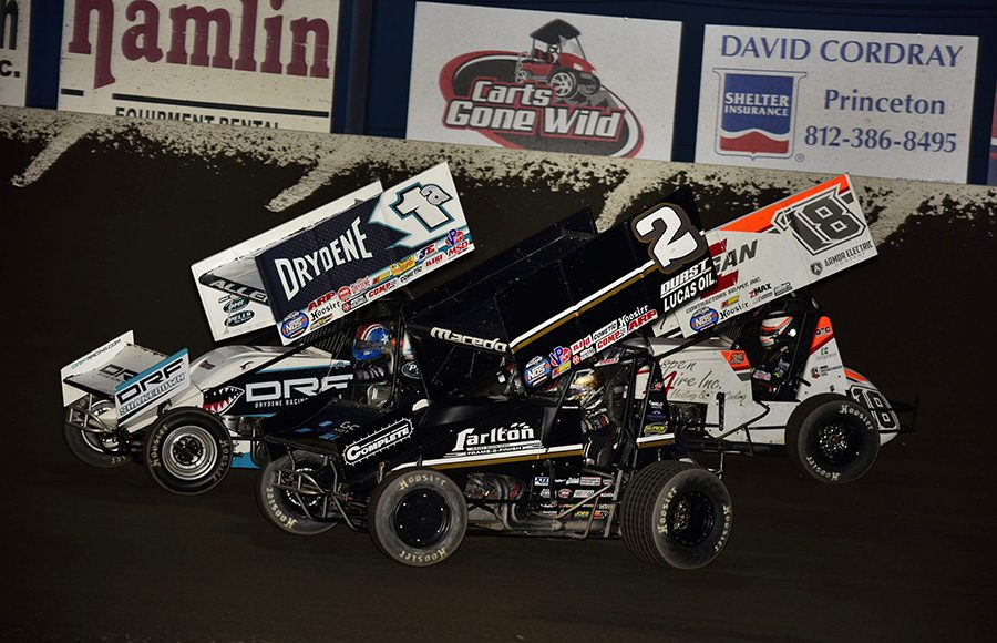 Jacob Allen (1a) battles Carson Macedo (2) and Ian Madsen during Saturday's World of Outlaws NOS Energy Drink Sprint Car Series event at Tri-State Speedway. (Mark Funderburk Photo)