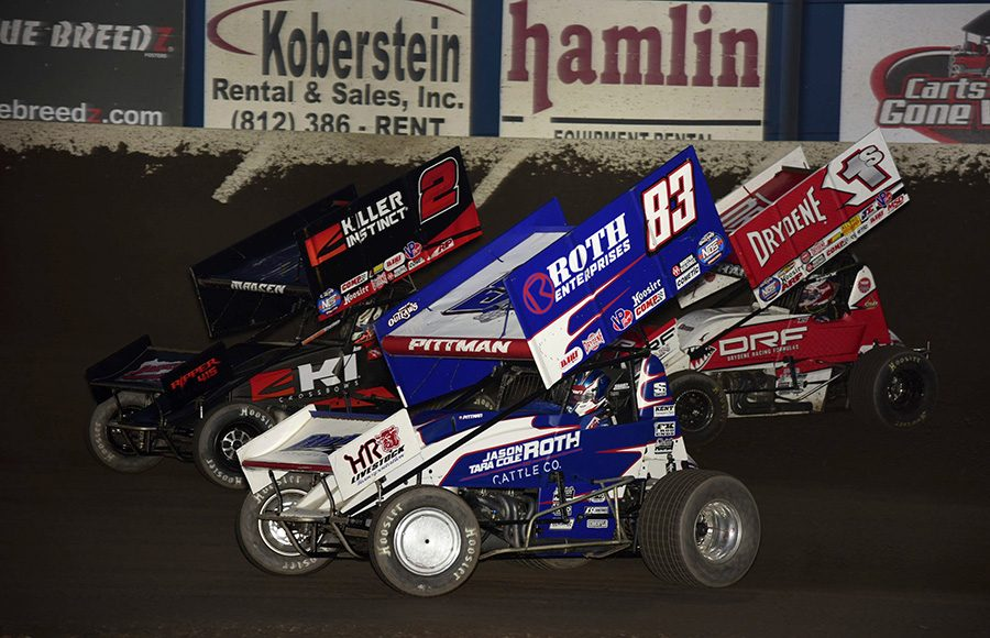 Daryn Pittman (83), Kerry Madsen (2) and Logan Schuchart battle it out during Saturday's World of Outlaws NOS Energy Drink Sprint Car Series event at Tri-State Speedway. (Mark Funderburk Photo)