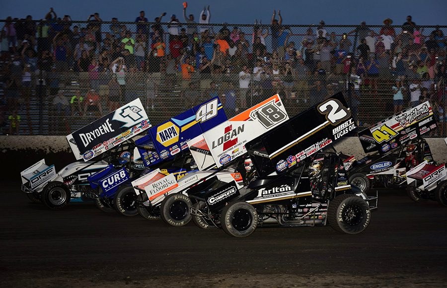 The field for Saturday's World of Outlaws NOS Energy Drink Sprint Car Series event salutes the fans by going four-wide at Tri-State Speedway. (Mark Funderburk Photo)