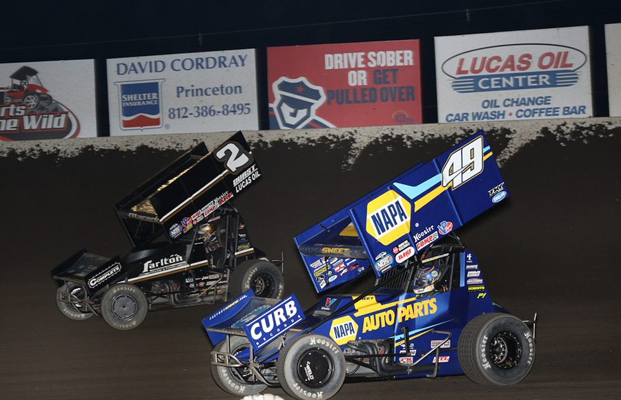 Brad Sweet (49) chases Carson Macedo during Saturday's World of Outlaws NOS Energy Drink Sprint Car Series event at Tri-State Speedway. (Neil Cavanah Photo)